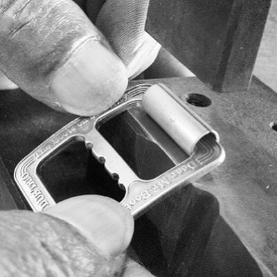 Creating original metal roller buckles for customer's original shoes and boots brand.