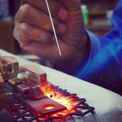 Welding and Creating original metal buckles,  Studs, Buttons and accessories for customer's original brand.