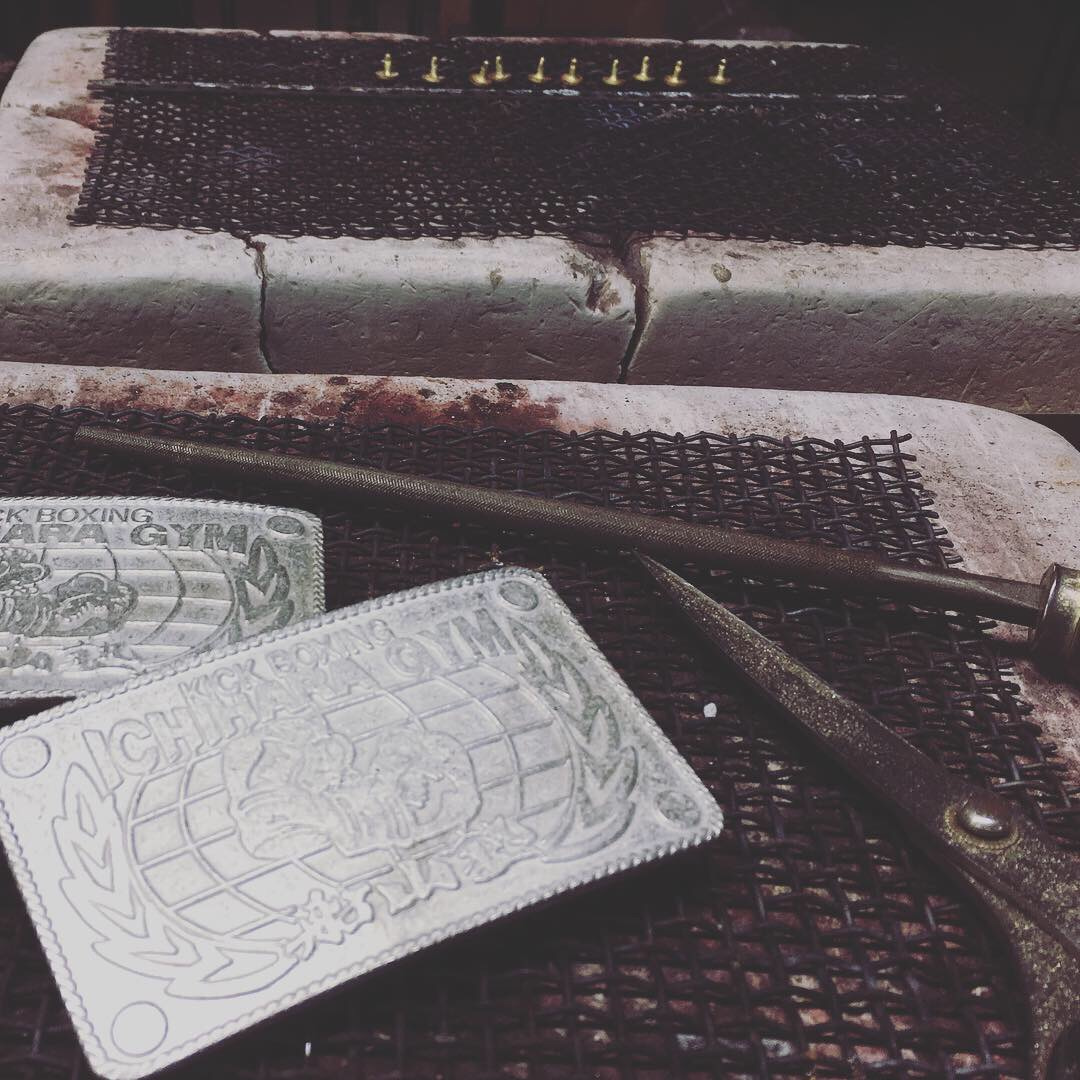 """In terms of requested logos, shapes, materials, we decided to use casting technics. Buckles are all handmade by our Japanese sophisticated craftsman. change the color, what we call """"AGING"""". You can enjoy them changing colors.      Original Metal buckles can be used for so many uses and giving some impact on your brand images."""
